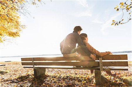 people sitting on bench - Couple sitting on bench, rear view Stock Photo - Premium Royalty-Free, Code: 649-07521114