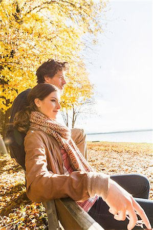fall trees lake - Couple sitting on bench Stock Photo - Premium Royalty-Free, Code: 649-07521115