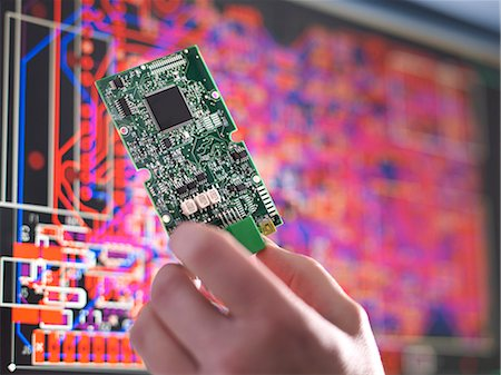 design - Close up of engineer holding electronic circuitry for automotive use Stock Photo - Premium Royalty-Free, Code: 649-07521183