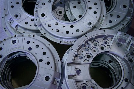 Close up of industrial clutch parts on production line, overhead view Stock Photo - Premium Royalty-Free, Code: 649-07521207