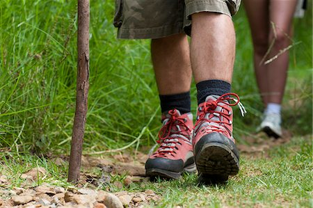 female hiking - Hikers legs and walking stick Stock Photo - Premium Royalty-Free, Code: 649-07559808