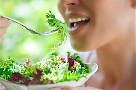 eating - Woman eating salad Stock Photo - Premium Royalty-Free, Code: 649-07559812