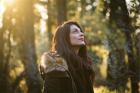Young woman in the woods Stock Photo - Premium Royalty-Free, Code: 649-07559825