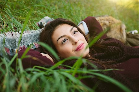 Young woman lying on blanket on grass Stock Photo - Premium Royalty-Free, Code: 649-07559826