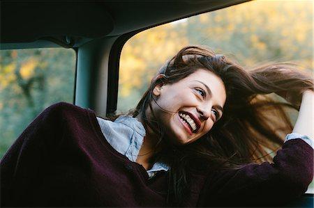 Young woman enjoying car ride Stock Photo - Premium Royalty-Free, Code: 649-07559823