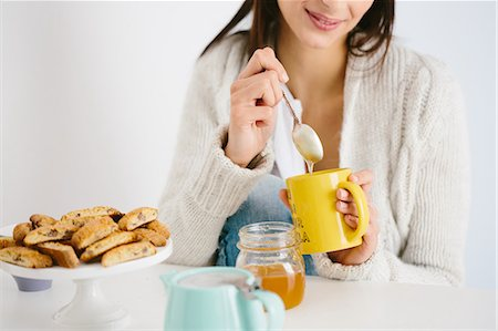 Young woman having honey drink Stock Photo - Premium Royalty-Free, Code: 649-07559843