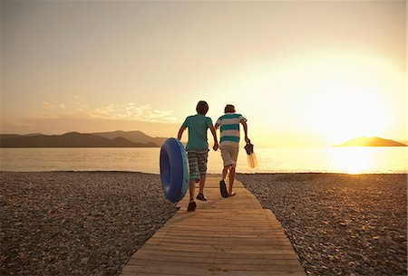 pre-teen beach - Teenage boy and brother running toward sea, Fethiye, Turkey Stock Photo - Premium Royalty-Free, Code: 649-07559944