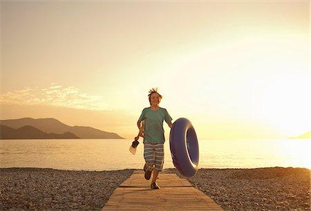 Brothers running on boardwalk, Fethiye, Turkey Stock Photo - Premium Royalty-Free, Code: 649-07559943