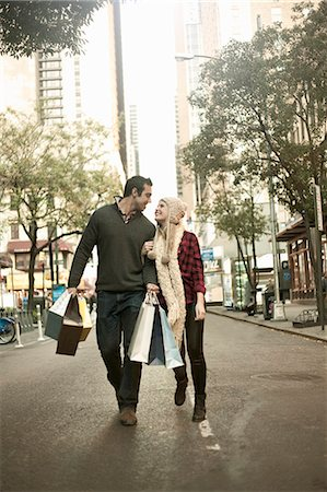 Young tourist couple with shopping bags, New York City, USA Stock Photo - Premium Royalty-Free, Code: 649-07559987