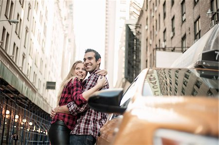 Young couple hugging next to yellow cab, New York City, USA Stock Photo - Premium Royalty-Free, Code: 649-07559994