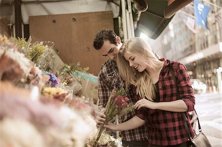 Young couple choosing flowers at flower stall Stock Photo - Premium Royalty-Free, Code: 649-07559998