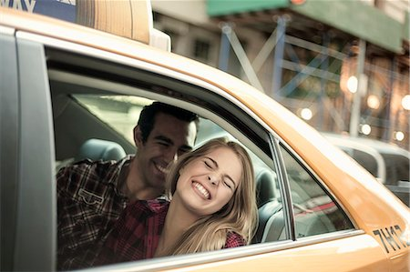 Young couple laughing in yellow cab, New York City, USA Stock Photo - Premium Royalty-Free, Code: 649-07559993