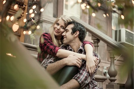 Happy couple sitting on traditional city apartment steps Stock Photo - Premium Royalty-Free, Code: 649-07560006