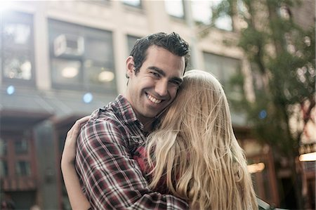 Happy young couple hugging on street, New York City, USA Stock Photo - Premium Royalty-Free, Code: 649-07560000
