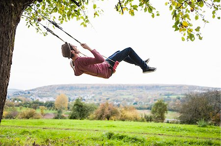 forward - Man on swing Stock Photo - Premium Royalty-Free, Code: 649-07560056