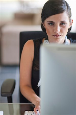 Young office worker using computer Stock Photo - Premium Royalty-Free, Code: 649-07560063