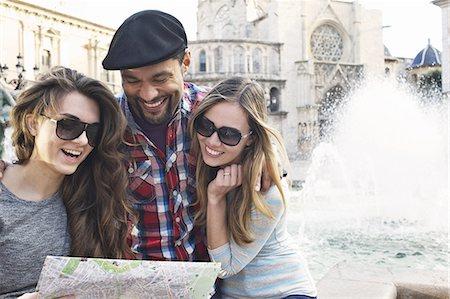 Tourist friends looking at map, Plaza de la Virgen, Valencia, Spain Stock Photo - Premium Royalty-Free, Code: 649-07560086