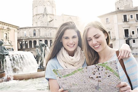 Two female tourists looking at map, Plaza de la Virgen, Valencia, Spain Stock Photo - Premium Royalty-Free, Code: 649-07560099