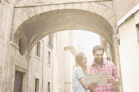 Young couple looking at map outside Valencia Cathedral, Valencia, Spain Stock Photo - Premium Royalty-Free, Code: 649-07560104