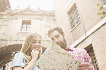 Young tourist couple looking at map outside Valencia Cathedral, Valencia, Spain Stock Photo - Premium Royalty-Free, Code: 649-07560105