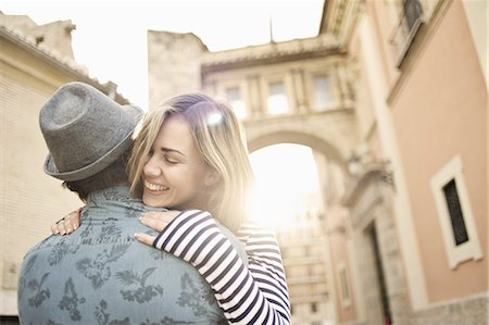 Young couple hugging, Valencia, Spain Stock Photo - Premium Royalty-Free, Code: 649-07560101