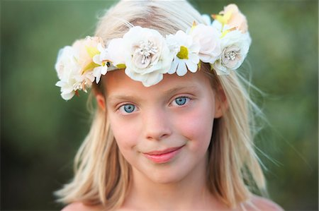 Portrait of girl with flower garland in her hair Stock Photo - Premium Royalty-Free, Code: 649-07560235