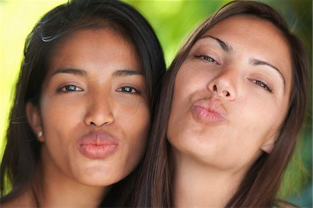 pucker - Close up portrait of two woman friends puckering lips Stock Photo - Premium Royalty-Free, Code: 649-07560237