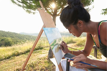 painting - Young female artist painting landscape, Buonconvento, Tuscany, Italy Stock Photo - Premium Royalty-Free, Code: 649-07560239