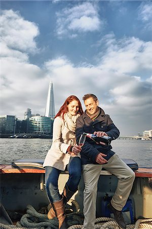Romantic couple on Thames boat sharing pink champagne, London, UK Stock Photo - Premium Royalty-Free, Code: 649-07560245