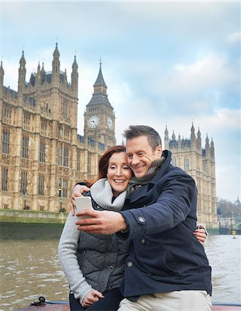 people and vacation - Mature tourist couple photographing selves and Houses of Parliament, London, UK Stock Photo - Premium Royalty-Free, Code: 649-07560242