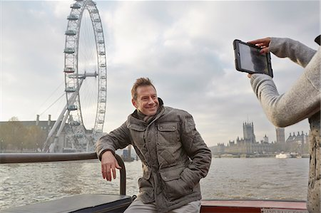 Mature tourist couple photographing selves and London Eye, London, UK Stock Photo - Premium Royalty-Free, Code: 649-07560254