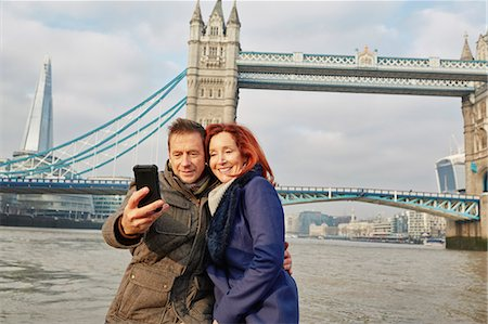 Mature tourist couple photographing selves and Tower Bridge, London, UK Stock Photo - Premium Royalty-Free, Code: 649-07560257