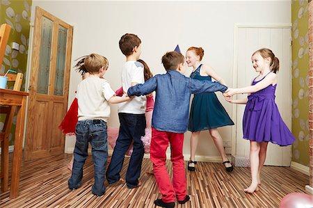 preteen dancing - Children dancing at birthday party Stock Photo - Premium Royalty-Free, Code: 649-07560315