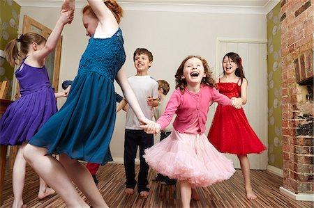 preteen dancing - Children dancing at birthday party Stock Photo - Premium Royalty-Free, Code: 649-07560316
