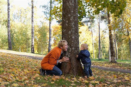 Father and son playing at bottom of tree Stock Photo - Premium Royalty-Free, Code: 649-07560335