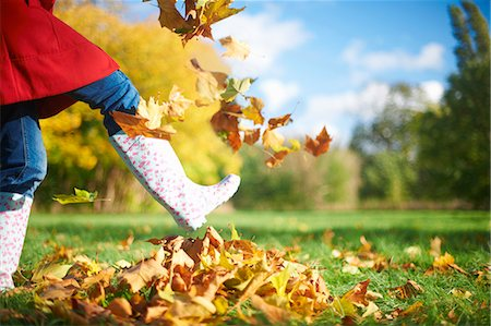 Cropped shot of mature woman kicking autumn leaves in park Stock Photo - Premium Royalty-Free, Code: 649-07560363