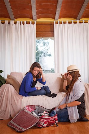Sisters packing luggage in room Stock Photo - Premium Royalty-Free, Code: 649-07560425