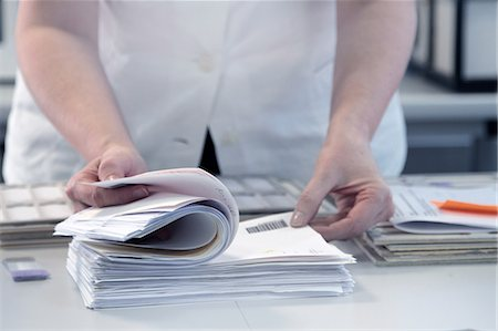 report - Female scientist checking through paperwork Stock Photo - Premium Royalty-Free, Code: 649-07560447
