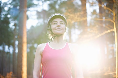 fitness   mature woman - Portrait of mature woman wearing bicycle helmet Stock Photo - Premium Royalty-Free, Code: 649-07560457