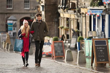 A young couple shop in the Grassmarket in Edinburgh, Scotland Stock Photo - Premium Royalty-Free, Code: 649-07560523