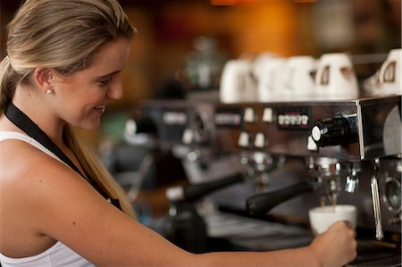 Young female waitress preparing coffee in cafe Stock Photo - Premium Royalty-Free, Code: 649-07585067