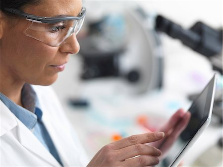 Female scientist viewing test results on a digital tablet in lab Stock Photo - Premium Royalty-Free, Code: 649-07585095
