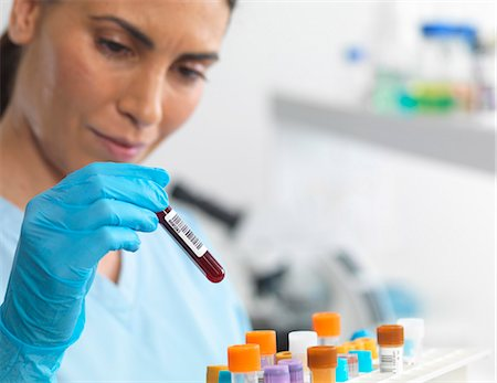 Scientist viewing various human samples for testing in the laboratory Stock Photo - Premium Royalty-Free, Code: 649-07585099