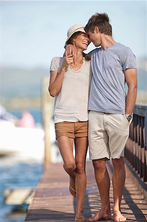 Young couple walking along jetty, arms around each other Stock Photo - Premium Royalty-Free, Code: 649-07585227