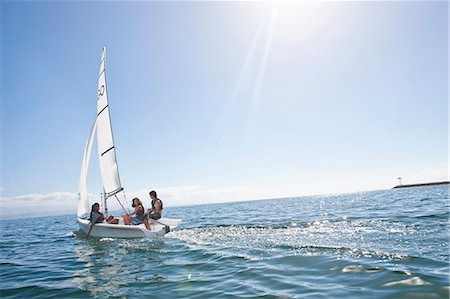 Three young friends sailing out from harbor Stock Photo - Premium Royalty-Free, Code: 649-07585249