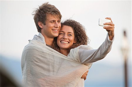 romance - Young couple taking picture of themselves Stock Photo - Premium Royalty-Free, Code: 649-07585241