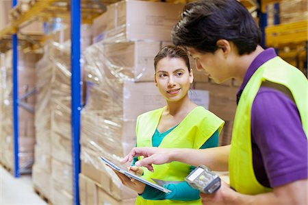 piles of work - Male and female workers using digital tablet in distribution warehouse Stock Photo - Premium Royalty-Free, Code: 649-07585266