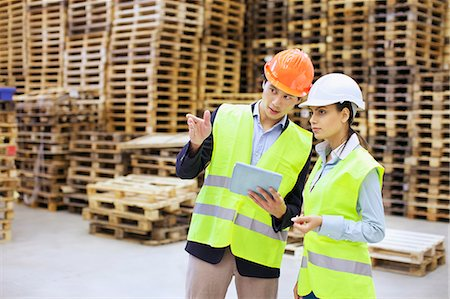 piles of work - Male and female managers using digital tablet in distribution warehouse Stock Photo - Premium Royalty-Free, Code: 649-07585261