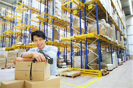 piles of work - Portrait of male manager in distribution warehouse Stock Photo - Premium Royalty-Free, Code: 649-07585275
