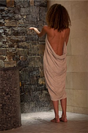 Young woman checking shower water in spa Stock Photo - Premium Royalty-Free, Code: 649-07585296